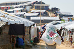 A Rohingya man carries home a bag of food provided by Caritas in the Mainerghona Refugee Camp near Cox's Bazar, Bangladesh, on October 27, 2017. Since August more than 600,000 Rohingya have fled government-sanctioned violence in Myanmar for safety in Bangladesh.