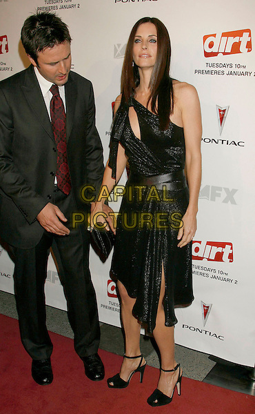 "DAVID ARQUETTE & COURTENEY COX ARQUETTE.The ""Dirt"" Hollywood premiere, Hollywood, California, USA, December 9th, 2006..full length black one shoulder dress cut out married husband wife courtney.CAP/ADM/RE.©Russ Elliot/AdMedia/Capital Pictures"