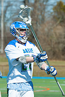Paul D'Anneo, '16, passes as he defends against Endicott in SRU Men's Lacrosse game action at Gaudet Field in Middletown.