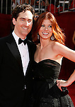 LOS ANGELES, CA. - September 21: Actress Debra Messing (R) and husband Daniel Zelman arrive at the 60th Primetime Emmy Awards at the Nokia Theater on September 21, 2008 in Los Angeles, California.