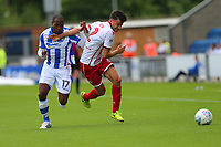 Jonathan Smith of Stevenage and Kyel Reid of Colchester United during Colchester United vs Stevenage, Sky Bet EFL League 2 Football at the Weston Homes Community Stadium on 12th August 2017