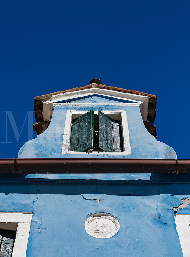 Colorful home facade in the Venetian fishing village island of Burano, Italy