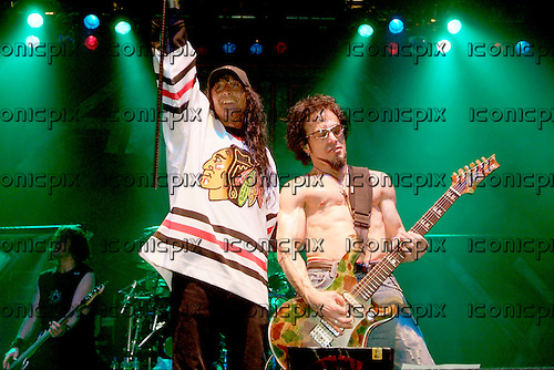 Anthrax - vocalist Joey Belladonna and guitarist Dan Spitz - performing live on the Among The Living Reunion Tour at the Ambassador Theatre, Dublin Ireland - 04 May 2005.  Photo by: George Chin/IconicPix