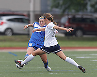 Boston Breakers forward Katie Schoepfer (12) dribbles as Sky Blue FC defender Madeleine Thompson (25) defends. In a National Women's Soccer League Elite (NWSL) match, Sky Blue FC (white) defeated the Boston Breakers (blue), 3-2, at Dilboy Stadium on June 16, 2013.