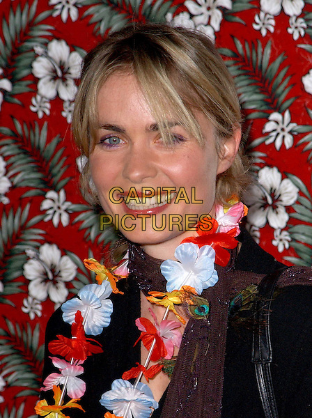RADHA MITCHELL.Los Angeles Premiere of 50 First Dates held at The Mann Village Theatre in Westwood, California.3 February 2004  .*UK Sales Only*.portrait, headshot, flower garland.www.capitalpictures.com.sales@capitalpictures.com.©Capital Pictures.