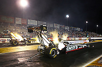 Sep 27, 2013; Madison, IL, USA; NHRA top fuel dragster driver Billy Torrence (near lane) races alongside Tony Schumacher during qualifying for the Midwest Nationals at Gateway Motorsports Park. Mandatory Credit: Mark J. Rebilas-