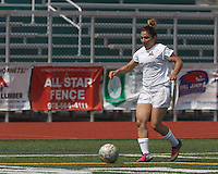 Boston Aztec defender Taleen Taylor (23) brings the ball forward.  In a Women's Premier Soccer League (WPSL) match, Boston Aztec (white) defeated Seacoast United Mariners (blue), 2-1, at North Reading High School Stadium on Arthur J. Kenney Athletic Field on on June 23, 2013. Due to injuries through the season, Seacoast United Mariners could only field 10 players.