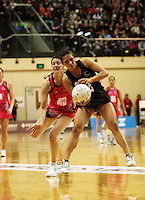 NZ wing attack Liana Barrett-Chase takes a pass under pressure from Peta Scholz during the International  Netball Series match between the NZ Silver Ferns and World 7 at TSB Bank Arena, Wellington, New Zealand on Monday, 24 August 2009. Photo: Dave Lintott / lintottphoto.co.nz