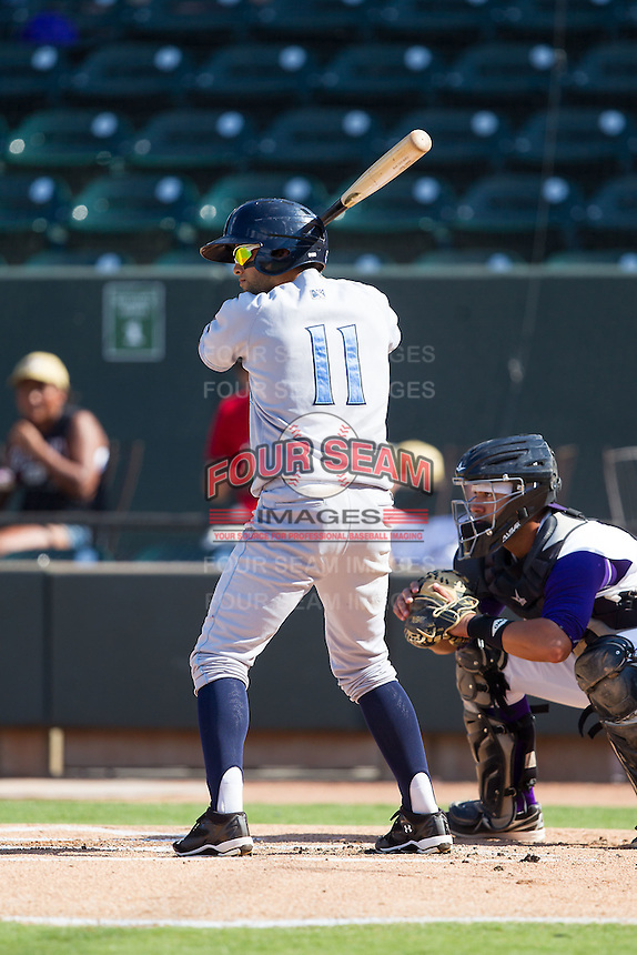 Jack Lopez (11) of the Wilmington Blue Rocks at bat against the Winston-Salem Dash at BB&T Ballpark on July 6, 2014 in Winston-Salem, North Carolina.  The Dash defeated the Blue Rocks 7-1.   (Brian Westerholt/Four Seam Images)