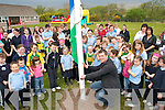 .GREEN TEAM; Former Kerry footballer Dara O'Cinneide joins pupils, teachers and parents at a Green Flag ceremony in Castledrum National School on Thursday last.   Copyright Kerry's Eye 2008