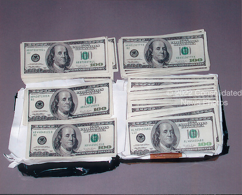 """Washington, DC - February 20, 2001 -- Package recovered at the """"Lewis"""" drop site on Vienna, Virginia containing $50,000 cash left by Russians for Hanssen..Credit: FBI via CNP"""