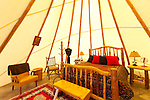 The Cherry Wood Bed, Breakfast and Barn features luxury teepees and horse rides.  The interior of the Lone Star Teepee
