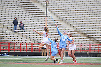 College Park, MD - February 24, 2019: North Carolina Tar Heels Ally Mastroianni (12) and Maryland Terrapins defender Lizzie Colson (25) tries to get the ball during the game between North Carolina and Maryland at  Capital One Field at Maryland Stadium in College Park, MD.  (Photo by Elliott Brown/Media Images International)