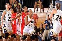 28 January 2012:  FIU forward-center Diamond Ashmore (13) handles the ball in the first half as the FIU Golden Panthers defeated the Western Kentucky University Hilltoppers, 60-56, at the U.S. Century Bank Arena in Miami, Florida.