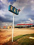 Restaurant sign on roadside in rural location in America