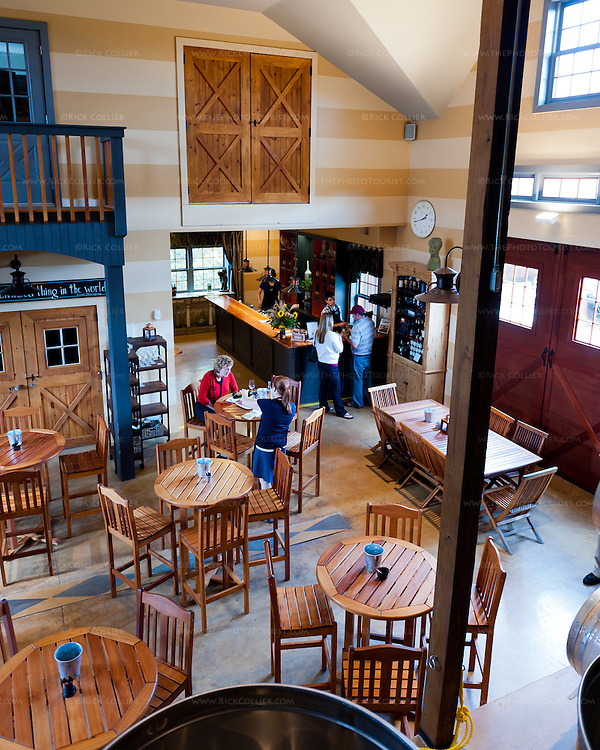 The upstairs balcony seats afford overwatch views of the tasting room below and into the wine bar serving area beyond.  (Vintage Ridge)