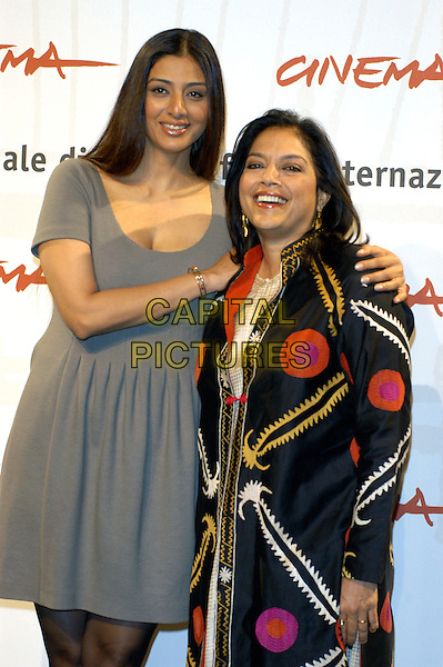 "TABU - TABBU & MIRA NAIR.Photocall for ""The Nakesake"" at the Rome Film Festival, Rome, Italy..October 16th, 2006.Ref: CAV.half length grey gray dress black roange pink yellow pattern top.www.capitalpictures.com.sales@capitalpictures.com.©Luca Cavallari/Capital Pictures."