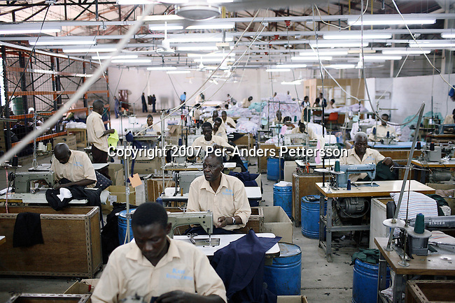 NDOLA, ZAMBIA MARCH 26: Zambian workers sew clothes at Kays textiles on March 26, 2007 in Ndola, Zambia. Most factories in the area have closed down due to cheap Chinese imports. The textile industry was the second biggest employer in Zambia before factories had to shut down or downsize. This factory employed hundreds of workers and now less than ten remain. Tens of thousands of Chinese has come to Africa the last years to work in infrastructure projects and businesses. Chinese companies are often the lowest bidders for contracts, pricing out the more expensive European companies. The Chinese people often live where they work and rarely interact with the local population. Most Chinese don't speak English and they are mostly staying in the compounds cooking their Chinese food, and watching Chinese Television and DVDs. (Photo by Per-Anders Pettersson)....