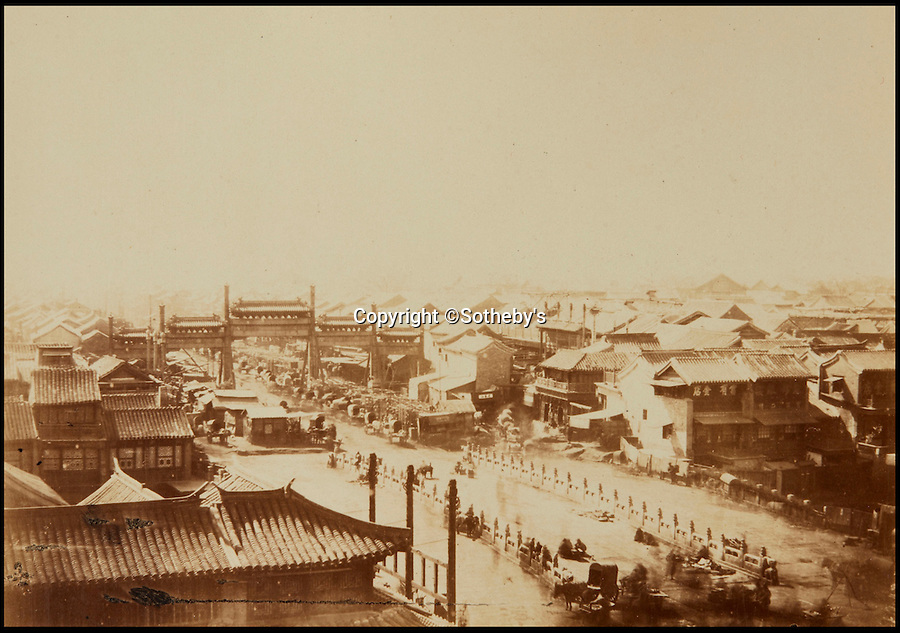 BNPS.co.uk (01202 558833)<br /> Pic: Sotheby's/BNPS<br /> <br /> Beijing street scene.<br /> <br /> A collection of rare early photographs capturing day-to-day life in China 150 years ago are set to sell for £80,000. <br /> <br /> The stunning album, comprising 41 black and white images of Beijing, depicts an array of busy street scenes and portraits of inhabitants from all walks of life. <br /> <br /> The pictures show chess players deep in concentration, musicians entertaining on the side of the road as well as striking images of the city's historically important architecture.