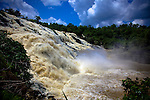 The impressive Gurara Falls, on the Gurara River in Nigeria's Niger State, is 200 meters wide, boasting a sheer drop of 30 meters.  Gurara Falls, an approximately 2-hour drive from the capital of Abuja, makes a pleasant day trip and picnic stop from the capital.  Signed open edition printed on Kodak Professional Endura Metallic paper, which brings out vivid colors.