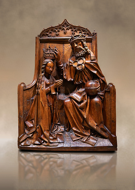 Gothic wood relief sculpture of the crwoning of of the Virgin Mary in the central European sgchiool style, end of 15th Century.  National Museum of Catalan Art, Barcelona, Spain, inv no: MNAC  5270. Against a art background.