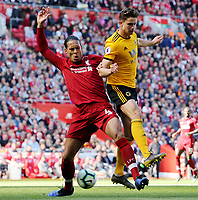 Liverpool's Virgil van Dijk battles with Wolverhampton Wanderers' Leander Dendoncker<br /> <br /> Photographer Rich Linley/CameraSport<br /> <br /> The Premier League - Liverpool v Wolverhampton Wanderers - Sunday 12th May 2019 - Anfield - Liverpool<br /> <br /> World Copyright © 2019 CameraSport. All rights reserved. 43 Linden Ave. Countesthorpe. Leicester. England. LE8 5PG - Tel: +44 (0) 116 277 4147 - admin@camerasport.com - www.camerasport.com