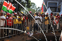 Independent Electoral and Boundaries Commission (IEBC) declared Uhuru Kenyatta as the winner of the presidential contest on 9 March 3013, after the failure of the electronic results transmission system delayed the process. Crowds of Jubilee supporters await an address by Uhuru Kenyatta and William Ruto at Catholic University, the Jubilee campaign headquarters, in Nairobi on 9 March 2013. AFP PHOTO / JENNIFER HUXTA