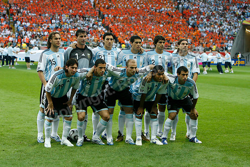 Jun 21, 2006; Frankfurt, GERMANY; The starting eleven for Argentina prior to the match against Netherlands in first round Group C action of the 2006 FIFA World Cup at FIFA World Cup Stadium Frankfurt. Front row: forward (19) Lionel Messi, midfielder (18) Maxi Rodriguez, midfielder (5) Esteban Cambiasso, forward  (11) Carlos Tevez and midfielder (8) Javier Mascherano. Back row: defender (15) Gabriel Milito, goalkeeper (1) Roberto Abbondanzieri, defender (21) Nicolas Burdisso,  midfielder (10) Juan Riquelme, defender (2) Roberto Ayala and defender (17) Leandro Cufre. Netherlands and Argentina tied 0-0. Mandatory Credit: Ron Scheffler-US PRESSWIRE Copyright © Ron Scheffler
