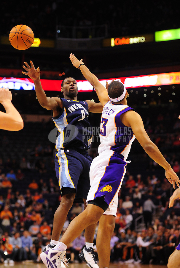 Jan. 28, 2012; Phoenix, AZ, USA; Memphis Grizzlies guard (9) Tony Allen passes the ball under pressure from Phoenix Suns forward (3) Jared Dudley in the first quarter at the US Airways Center. Mandatory Credit: Mark J. Rebilas-.