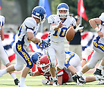 SIOUX FALLS, SD - SEPTEMBER 7:  Luke Fritsch #10 from O'Gorman pitches the ball to teammate Eion Donelan #30 in the second quarter of their game against Lincoln at the 2013 Presidents Bowl at Howard Wood Field. (Photo by Dave Eggen/Inertia)