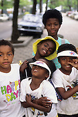 "Rio de Janeiro, Brazil. Group of Afrobrazilian street kids, one wearing a ""Happy Days are Here again"" t-shirt."