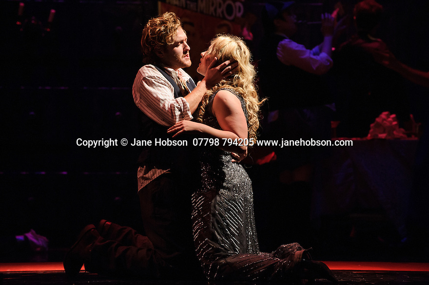 London, UK. 07.10.2015. English Touring Opera presents THE TALES OF HOFFMANN, at the Britten Theatre, Royal College of Music. Written by Jacques Offenbach, with libretto by Jules Barbier, this production is directed by James Bonas. Picture shows: Sam Furness (Hoffmann), Ilona Domnich (Giulietta). Photograph © Jane Hobson.