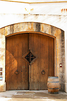 The big wooden entrance door to the Chateau Romanin winery. Chateau Romanin, Saint Remy de Provence, Bouches du Rhone, Provence, France, Europe