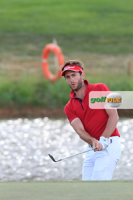 Edouard Espana (FRA) chipping onto the 16th green during Round 2 of the Open de Espana  in Club de Golf el Prat, Barcelona on Friday 15th May 2015.<br /> Picture:  Thos Caffrey / www.golffile.ie