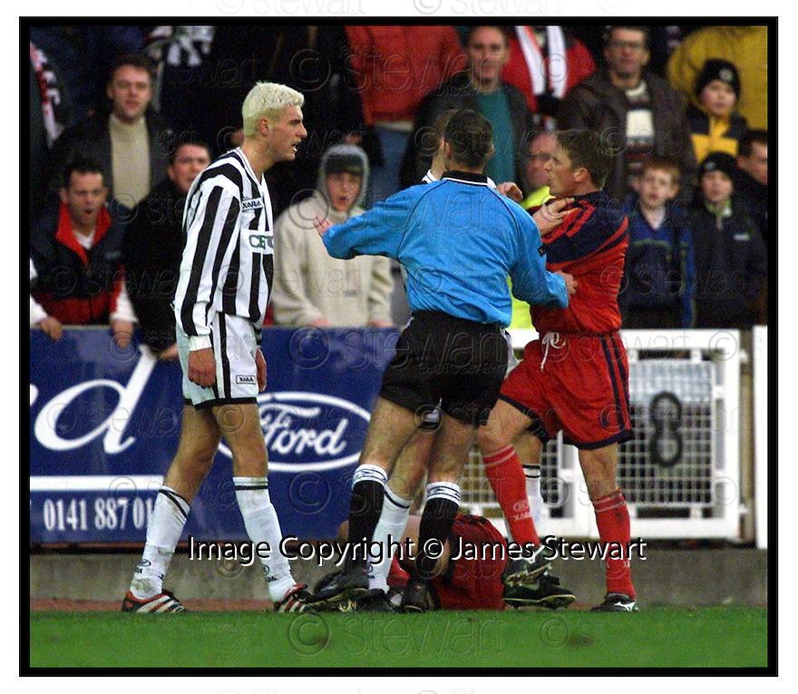 4th December 1999          Copyright Pic : James Stewart .Ref :                           .File Name : stewart07-st mirren v falkirk                        .REF MIKE MCCURRY STEPS IN AS SERGI BALTACHA  IS COMFRONTED BY SCOTT CRABBE AFTER HIS LATE CHALLENGE ON GARETH HUTCHISON.......Payments to :-.James Stewart Photo Agency, Stewart House, Stewart Road, Falkirk. FK2 7AS      Vat Reg No. 607 6932 25.Office : +44 (0) 1324 630007        Mobile : 07721 416997.Fax     : +44 (0) 1324 630007.E-mail : jim@jspa.co.uk.If you require further information then contact Jim Stewart on any of the numbers above.........
