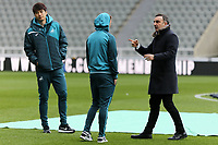 Ki Sung-Yueng and Tom Carroll of Swansea City are spoken to by Swansea manager Carlos Carvalhal prior to the game during the Premier League match between Newcastle United and Swansea City at St James' Park, Newcastle, England, UK. Saturday 13 January 2018