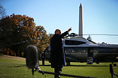 United States President Donald J. Trump waves as he walks on the South Lawn of the White House before boarding Marine One on November 4, 2018 in Washington, DC. <br /> Credit: Oliver Contreras / Pool via CNP