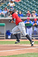 Birmingham Barons left fielder Eloy Jimenez (21) runs to first base during a game against the Tennessee Smokies at Smokies Stadium on May 6, 2018 in Kodak, Tennessee. The Smokies defeated the Barons 6-2. (Tony Farlow/Four Seam Images)