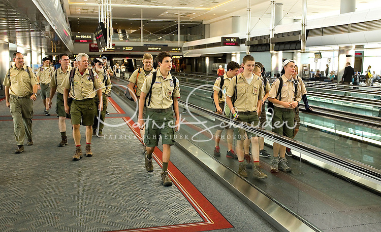 Photo story of Philmont Scout Ranch in Cimarron, New Mexico, taken during a Boy Scout Troop backpack trip in the summer of 2013. Photo is part of a comprehensive picture package which shows in-depth photography of a BSA Ventures crew on a trek. In this photo, a Boy Scout Venture Crew makes their way through  Denver International Airport en route to Philmont Scout Ranch, Cimarron, New Mexico.<br /> <br /> Photo by travel photograph: PatrickschneiderPhoto.com