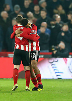 24th November 2019; Bramall Lane, Sheffield, Yorkshire, England; English Premier League Football, Sheffield United versus Manchester United; Lys Mousset of Sheffield United gets a hug John Fleck  of Sheffield United after he scores in the 52nd minute to make it 2-0 - Strictly Editorial Use Only. No use with unauthorized audio, video, data, fixture lists, club/league logos or 'live' services. Online in-match use limited to 120 images, no video emulation. No use in betting, games or single club/league/player publications