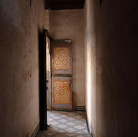 Vestibule with painted door leading to the main terrace area, Glaoui Palace, early 19th century, in Fes, Fes-Boulemane, Northern Morocco. Thami Glaoui, Pasha of Marrakech, used this as his Fes residence. The complex consists of 30 fountains, 17 houses, 2 hammams, an oil mill, a mausoleum and cemetery, a madrasa, gardens and stables. Picture by Manuel Cohen