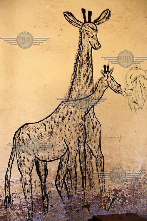A mural of giraffes on the wall of a classroom at an elementary school in the village in Fono, Segou.