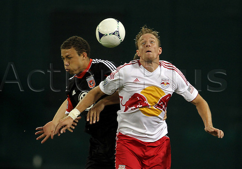 29.08.2012. Washinton, DC.   Nick DeLeon (18) of DC United goes for a header with Jan Gunnar Solli (8) of the New York Red Bulls during an MLS match at RFK Stadium, in Washington DC. The game ended in a 2-2 tie.