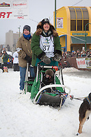 Christine Roalofs and team leave the ceremonial start line at 4th Avenue and D street in downtown Anchorage during the 2013 Iditarod race. Photo by Jim R. Kohl/IditarodPhotos.com