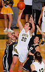 SPEARFISH, SD - FEBRUARY 22, 2014:  Gabby Haefs #20 of Black Hills State gets a layup between defenders from UC-Colorado Springs during their Rocky Mountain Athletic Conference game Saturday at the Donald E. Young Center in Spearfish, S.D.  (Photo by Dick Carlson/Inertia)