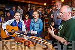 Kelsey McCarthy, Sarah Landers & Mick Power playing at Mac's Melting Pot Session in Mike Murts Bar Cahersiveen on Sunday part of the Mountain Roots Music Festival.