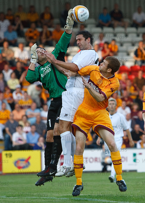 Llanelli goalie Ashley Morris palms a shot off the head of Motherwell's Mark Reynolds