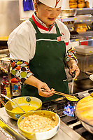 Nanjing, Jiangsu, China.  Cook in Restaurant Kitchen Making Egg Dumplings with Pork.