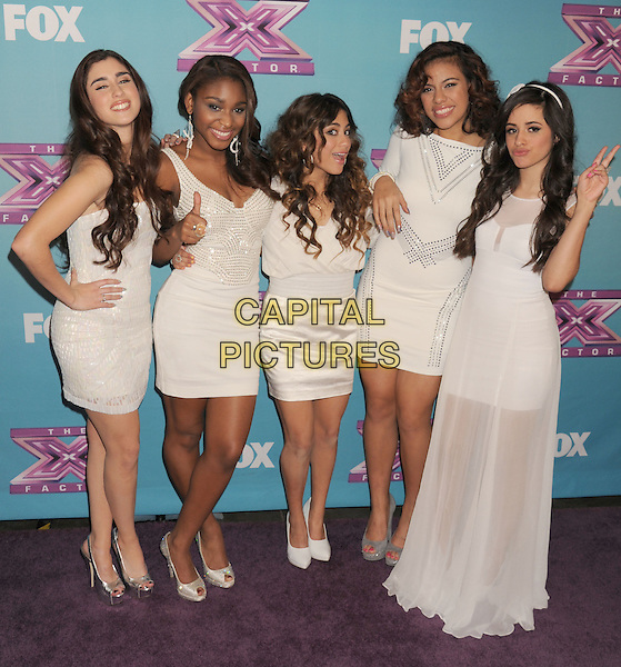 Fifth Harmony - Lauren Juaregui, Normani Kordei, Ally Booke, Dinah Jane Hansen, Camila Cabello.arriving at Fox's 'The X Factor' Season Finale Night 1 at CBS Televison City in Los Angeles, California, USA, .December 19th, 2012.  .full length white dress group band  sheer long maxi studded hand on hip  thumb up peace sign .CAP/ROT/TM.©Tony Michaels/Roth Stock/Capital Pictures