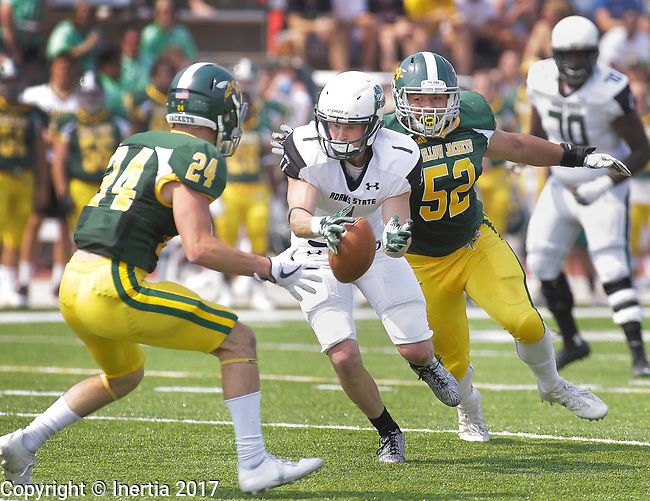 SPEARFISH, SD: SEPTEMBER 2: James Holtrop #1 of Adams State tries to hang onto the ball while running between Black Hills State defenders Drew Hebel #24 and Isaiah Birkel #52 during their game Saturday at Lyle Hare Stadium in Spearfish, S.D.   (Photo by Dick Carlson/Inertia)